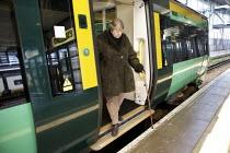 Disabled persons using the railways. - Duncan Phillips - 2000s,2008,Access,carriage,carriages,cities,city,disabilities,disability,disable,disabled,disablement,disembarking,door,doors,FEMALE,getting,incapacity,journey,journeys,london,minorities,needs,network