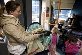 Family and disabled persons using the railways. - Duncan Phillips - ,2000s,2008,Access,adult,adults,carriage,carriages,child,CHILDHOOD,children,cities,city,disabilities,DISABILITY,disable,disabled,disablement,disembarking,EBF economy,families,family,female,females,get