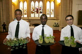 Waiters serving drinks, London. - Duncan Phillips - 2010s,2015,BAME,BAMEs,Black,BME,bmes,cities,city,Diaspora,diversity,EARNINGS,eastern,EBF,Economic,Economy,employee,employees,Employment,EQUALITY,ethnic,ethnicity,eu,european,europeans,foreign,foreigne