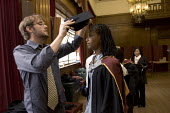 University Graduation at Guildhall, in London. - Duncan Phillips - mortarboard,2000s,2005,BAME,BAMEs,Black,BME,bmes,ceremonies,ceremony,cities,city,degree,degrees,diversity,edu,educate,educating,education,educational,ethnic,ethnicity,FEMALE,gown,gowns,graduate,gradua