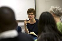 University professor teaching an evening class in creative writing. - Duncan Phillips - 29-05-2008