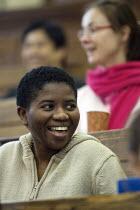 Students in a university lecture. - Duncan Phillips - 2000s,2005,BAME,BAMEs,BIOLOGICAL,biology,Black,BME,bmes,communicating,communication,diversity,edu,educate,educating,education,educational,EMOTION,EMOTIONAL,EMOTIONS,ethnic,ethnicity,FEMALE,funny,Highe