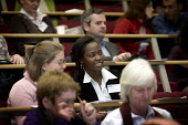 Students in a university lecture. - Duncan Phillips - 2000s,2005,BAME,BAMEs,Black,BME,bmes,communicating,communication,diversity,edu,educate,educating,education,educational,EMOTION,EMOTIONAL,EMOTIONS,ethnic,ethnicity,FEMALE,Higher Education,knowledge,lea