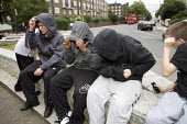 Youths wearing hoodies hanging out on a street corner, Camden, London. - Duncan Phillips - 21-09-2007