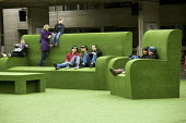 Relaxing on giant green three piece suite by Angus MacKechnie, Watch This Space 2008, South Bank, London - Duncan Phillips - 2000s,2009,ACE,adult,adults,armchair,art,arts,artwork,artworks,Astroturf,Bank,BANKS,boy,boys,child,CHILDHOOD,children,cities,city,culture,FAMILY,female,females,festival,FESTIVALS,friend,friends,furnit