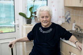 A ninety year old lady at home. uk - Duncan Phillips - 2010,2010s,access,adult,adults,age,ageing population,apartment,apartments,cities,city,disabilities,disability,disable,disabled,disablement,elderly,fail,FEMALE,flat,flats,frailty,home,homes,house,house