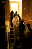 Children Trick or Treating on the doorstep, Halloween, London - Duncan Phillips - 2000s,2009,ACE,at,boy,boys,child,CHILDHOOD,children,cities,city,costume,costumes,culture,doorstep,halloween,home,homes,house,houses,juvenile,juveniles,kid,kids,Leisure,LFL,LIFE,london,male,mask,masked