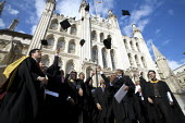 University Graduation, Guildhall, London. Throwing their mortarboards in the air. - Duncan Phillips - 15-03-2010