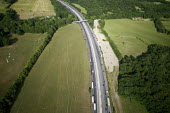Aerial View of M25 motorway - Duncan Phillips - 2010s,2013,aerial,country,countryside,east,EBF,Economic,Economy,farm,farmed,farming,farmland,farms,field,fields,highway,infrastructure,M25,motorway,MOTORWAYS,outdoors,outside,producer,road,roads,rural
