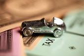 Monopoly board and pieces. - Duncan Phillips - 2000s,2006,AUTO,AUTOMOBILE,AUTOMOBILES,AUTOMOTIVE,bank,BANKS,board,building,BUILDINGS,car,CARS,domestic,economic,economy,ELECTRICAL,electricity,finance,FINANCIAL,game,home,house,houses,housing,money,m