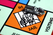 Monopoly board and pieces. - Duncan Phillips - ,2000s,2006,and,AUTO,AUTOMOBILE,AUTOMOBILES,AUTOMOTIVE,bank,BANKS,board,building,BUILDINGS,buy,buyer,buyers,buying,car,CARS,commodities,commodity,domestic,economic,economy,ELECTRICAL,electricity,estat