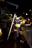 A council contractor clearing a storm drain. Harrow. London - Duncan Phillips - 09-02-2007