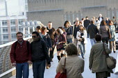 Crowds, crossing the millenium bridge, London - Duncan Phillips - 2000s,2009,adult,adults,asian,asians,BAME,BAMEs,BME,bmes,bridge,cities,city,COMMUTE,COMMUTER,commuters,COMMUTING,cross,crosses,crossing,diversity,ethnic,ethnicity,holiday,holiday maker,holiday makers,