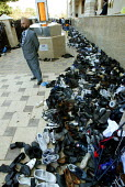 The shoes of Sikh worshipers shoes at the opening of the new gurdwara Temple in Southall, the largest sikh temple in Europe. - Duncan Phillips - 2000s,2003,and,asian,ASIANS,BAME,BAMEs,black,BME,bmes,ceremonies,ceremony,congregation,diversity,ethnic,ethnicity,faith,female,god,gudwara,gurdwara,Gurdwara Sri Singh Sabha temple,guru,inclusive,male,