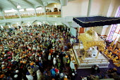 Sikh worshipers at the opening of the new Gurdwara Temple in Southall, the largest sikh temple in Europe. - Duncan Phillips - 2000s,2003,and,asian,ASIANS,BAME,BAMEs,black,BME,bmes,ceremonies,ceremony,congregation,Crowd,diversity,ethnic,ethnicity,faith,female,god,gudwara,Gurdwara,Gurdwara Sri Singh Sabha temple,guru,inclusive