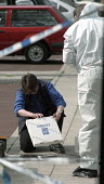 Scene of crime officers collect evidence and take photographs at a crime scene, islington, London - Duncan Phillips - 25-01-2002