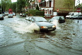 Flooding due to heavy rainfall. London - Duncan Phillips - 2000,2000s,AUTO,AUTOMOBILE,AUTOMOBILES,AUTOMOTIVE,BAD,car,cars,Climate Change,drive,DRIVER,DRIVERS,driving,eni environmental issue,EXTREME,flood,flooded,flooding,floods,heavy,highway,journey,JOURNEYS,