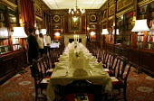 Library of the Oriental Gentlemans Club, set for dinner. London - Duncan Phillips - 2000s,2003,ace culture,AFFLUENCE,AFFLUENT,Bourgeoisie,business,Candlelit,catering,cities,city,class,club,clubs,dinner,dinners,Dinning,elite,elitism,employee,employees,Employment,EQUALITY,exclusive,foo