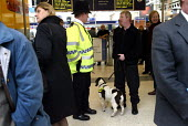 BT Police on patrol with a sniffer dog at Liverpool Street Station, London. Anti terrorism. - Duncan Phillips - 2000s,2004,adult,adults,animal,animals,canine,CLJ crime law,dog,dogs,journey,journeys,Liverpool,MATURE,metropolitan police service,network,passenger,passengers,Patrol,patrolling,people,platform,PLATFO