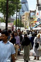Multicultural Street Scene, Whitechapel market London. - Duncan Phillips - 2000s,2004,asian,BAME,BAMEs,black,BME,bmes,bought,burka,burkas,burqa,burqas,buy,buyer,buyers,buying,cities,city,commodities,commodity,consumer,consumers,cultural,customer,customers,diversity,dress,eas