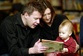 Parents reading books to preschool children at a Public library, London. - Duncan Phillips - 19-01-2004