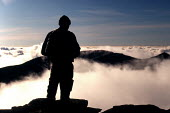 Walker above the clouds admiring the view Scafell Pike, The Lake District - Duncan Phillips - 2000s,2002,altitude,climber,climbers,climbing,cloud,clouds,conservation,country,countryside,eni,eni environmental issue,environment,Environmental Issues,exercise,exercises,fell,healthy,height,high,Lak