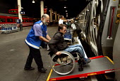Wheelchair user boarding train Euston Station, London - Duncan Phillips - 27-09-2004
