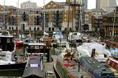 New housing . Limehouse Basin London - Duncan Phillips - 2000s,2004,AFFLUENCE,AFFLUENT,apartment,block,blocks,boat,boats,Bourgeoisie,cities,city,cityscape,cityscapes,developer,developers,DEVELOPMENT,DOCKLAND,docklands,EBF economy,elite,elitism,EQUALITY,high