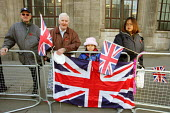 Spectators with Union Flag, Lord Mayors Show, London - Duncan Phillips - 2000s,2004,Barbican,crowd,flag,flags,London,Lord,LORDS,Mayor,MAYORAL,MAYORS,nationalism,people,procession,Show,spectator,Spectators,street,Union Jack