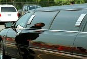 Chauffeur reflected in stretch limo. Detroit USA - Duncan Phillips - American,2000s,2003,AFFLUENCE,AFFLUENT,America,American,americans,AUTO,AUTOMOBILE,AUTOMOBILES,AUTOMOTIVE,Bourgeoisie,car,cars,chauffeur,Detroit,driver,DRIVERS,DRIVING,elite,elitism,EQUALITY,high,high