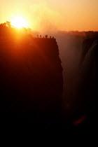 Victoria Falls, Zimbabwe / Zambia Border - Duncan Phillips - 1990s,1998,Border,eni environmental issue,environment,holiday,holiday maker,holiday makers,holidaymaker,holidaymakers,holidays,LFL Leisure,nature,people,person,persons,SUN,sunset,SUNSETS,tourism,touri