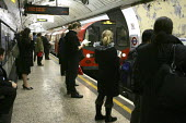 Commuter's travelling on the london Underground - Duncan Phillips - 14-12-2004