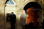 Waiting to use the Cash Machine. Stafford. - Duncan Phillips - 16-12-2004