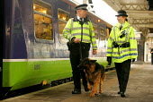 British Transport Police Officers Patrol the North London Line in an attempt to improve Security and safety. - Duncan Phillips - 2000s,2004,adult,adults,animal,animals,canine,CLJ crime law,crime,dog,dogs,FEMALE,London,MATURE,metropolitan police service,network,Officer,officers,Patrol,people,person,persons,platform,PLATFORMS,Pol