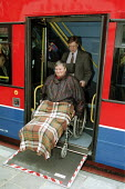 Disabled passengers boarding a kneeling accessible bus, London - Duncan Phillips - 2000s,2005,access,accessible,boarding,bound,bus,bus service,buses,cities,city,disabilities,disability,disable,disabled,disablement,FEMALE,getting,incapacity,journey,journeys,London,minorities,mobility
