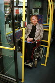 Disabled passengers onboard a kneeling accessible bus, London - Duncan Phillips - 2000s,2005,access,accessible,bound,bus,bus service,buses,cities,city,disabilities,disability,disable,disabled,disablement,FEMALE,getting,incapacity,journey,journeys,London,minorities,mobility,needs,of