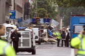 London double decker bus destroyed by suspected suicide bomber. Upper Woburn Sq and Taverstock Square. London - Duncan Phillips - 2000s,2005,7/7,adult,adults,attack,attacking,attacks,blast,bomb,bombing,bombings,bombs,bus,bus service,buses,CLJ,death,deaths,died,explosion,EXPLOSIONS,fatal,fatality,fatally,forensic,FORENSICS,incide