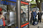 Londoners using public telephones at the scene of London double decker bus destroyed by suspected suicide bomber London - Duncan Phillips - 07-07-2005