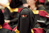 Muslim woman at Graduation ceremony, the Barbican, London - Duncan Phillips - &,2010s,2013,achievement,apparel,asian,asians,BAME,BAMEs,belief,Black,BME,bmes,burka,burkas,burqa,burqas,ceremonies,ceremony,cities,city,clothes,clothing,conviction,degree,degrees,diversity,dress,edu,