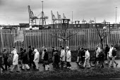 Liverpool Docks 1996. Striking dockers walk back from a picket during the two and a half year long dock dispute during which 400 dockers were sacked for refusing to cross a picket line, during which t... - David Sinclair - Trades Union,1990s,1996,ANGER,angry,bitter,cargo,conflict,confront,Confrontation,confronted,confronting,container,containers,crane,crane skyline,cranes,dispute,DISPUTES,dock,DOCK WORKER,DOCK WORKERS,d