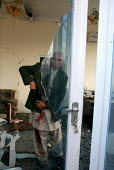 Afghanistan The owner of a small real estate agency prepares to go to the hospital following a suicide attack that targeted a foreign military convey in Kabul on November 27th. The suicide car bomb ki... - Elissa Bogos - 27-11-2007