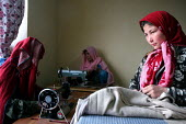 Women training to become tailors in Bamiyan Afghanistan. Because they cannot work at their respective jobs during this time, the training center provides the women with 50 Afghanis ($1.00) per day. Ba... - Elissa Bogos - 01-12-2007