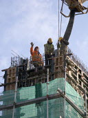 Construction workers working on the site of the new RSC theatre, Stratford upon Avon. - Emilio Villano-Harris - 31-10-2008