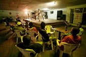 Harare, Zimbabwe. Unemployed Zimbabweans relax in a bar in Warren Park, outside Harare. - Felipe Trueba - 20-11-2007