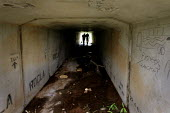 Beitbridge / South Africa Two men inspect a tunnel under a road outside Musina. Migrants use these places to live and sleep as they wait for a transport that will carry them to Pretoria or Johannesbur... - Felipe Trueba - 25-11-2007