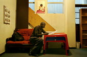 Johannesburg, South Africa, November 2007. A man, who just arrived from Zimbabwe, fills in some papers in the Zimbabwe Political Victims Association (ZIPOWA) in Johannesburg. Many inmigrants apply for... - Felipe Trueba - 09-11-2007