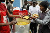 Johannesburg, South Africa.. Without any money to buy food many Zimbabweans depend on the help of charity organizations which distribute food for free in different places around Johannesburg. - Felipe Trueba - 08-11-2007