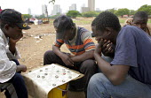 Pretoria, South Africa. Refugees from Zimbabwe near the Marabastad Refugee Reception Centre (Ministry of Home Affairs) in Pretoria where they apply for a South African visa. Because of administrative... - Felipe Trueba - 2000s,2007,African,african africans,Asylum Seeker,Asylum Seeker,board,checkerboard,chess,chessboard,diaspora,displaced,draughts,EQUALITY,excluded,exclusion,foreign,foreigner,foreigners,game games,HARD