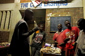 Harare, Zimbabwe. Unemployed Zimbabweans in a bar in Warren Park, outside Harare. A few food items are for sale. - Felipe Trueba - 20-11-2007