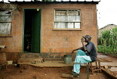 Harare - Zimbabwe. People who were forced to move by the Zimbabwean government during operation Murambatsvina in 2005 returned to Harare. They squatted a piece of land in the outskirts of the high den... - Felipe Trueba - ,2000s,2007,clearance,clearances,CLEARENCE,displaced,displacement,ELECTRICAL,electricity,EQUALITY,excluded,exclusion,government,HARDSHIP,home,homeless,homelessness,homes,housing,hut,huts,IDP,IDPs,impo